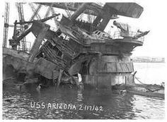 The Arizona sinking in Pearl Harbor on December 7, 1941.  There is a beautiful memorial that was built over its remains.