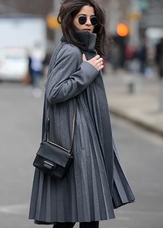 pleated gray coat in the streets of New York. #NYFW