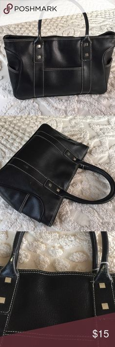 Black leather tote Black leather tote or laptop bag. Very roomy. One zip pocket inside. Magnet closure. Small slip pockets on ends and one on front. Reposh because my laptop is too big. Ellen Tracy Bags Laptop Bags