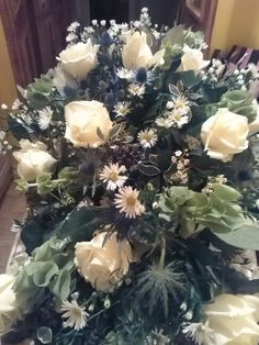 Whites and greens, natural funeral design Flora Button funeral flowers Leicestershire