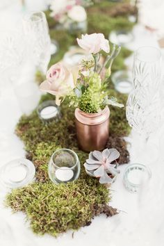 Botanical Moss & succulents table runner with votives & spray painted copper jars - Image by Craig & Eva Sanders Photography - Bride in a Bespoke Gown with Gold Christian Louboutin Shoes, for an outdoor humanist ceremony in Wales with pastel colour scheme & copper hints.