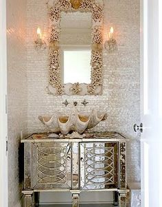 The tile in this bathroom combined with the shell sink is drop dead. I bet the light in this powder room is very forgiving.