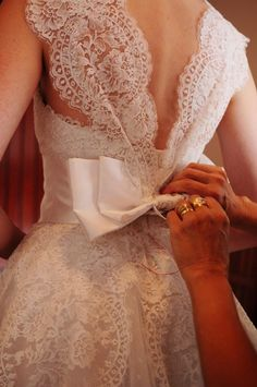 Love the vintage lace and bow wedding dress
