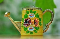 My first vintage item on etsy...    Miniature watering can painted yellow and gold by PearlsandChina