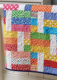 Pull out your cheeriest fabrics for this easy quilt. Get the pattern here: http://quiltingdigest.com/pull-out-your-brightest-fabrics-for-this-easy-quilt/