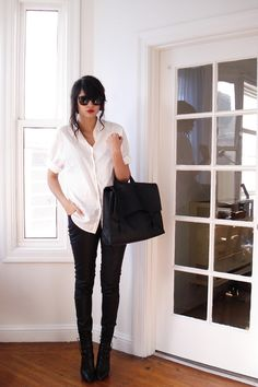 white shirt, black pants and boots
