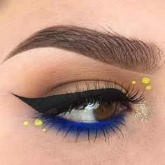 Yesterday's spirit makeup for my school's end of the year rally 💛💙 I used @makeupgeekcosmetics frappe, mocha, mirage, neptune, and asteroid sparkler, @makeupforeverus Aqua XL liner in m-22, @limecrimemakeup liquid liner in citreuse, and @eylureofficial exaggerate #143 lashes  #batalash #vegas_nay #jaclynhill #morphebrushes #nikkietutorials #anastasiabeverlyhills #hudabeauty #sephora #makeupforever #makeupgeekcosmetics #kvdlook