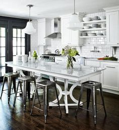 Ingrid Ooman's white kitchen with bistro bar stools – house and home via Atticmag