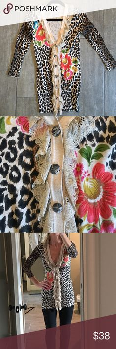 Leopard tunic sweater This leopard tunic sweater has beautiful lace detail, even on the buttons. Worn a handful of times, just dry cleaned and in perfect condition. Charlotte Tarantola Tops