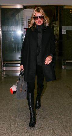 Pin for Later: Kate Moss Adds Another Amazing All-Black Look to Her Wardrobe At the London Eurostar Terminal, en route to Paris, Kate looked polished and chic in all black, including knee-high boots and a peacoat.