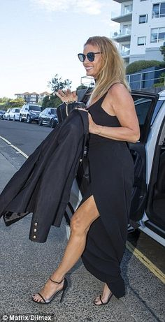 Elegant:The mother-of-one went with a classic black dress that featured a thigh high split and revealed her toned trim pins
