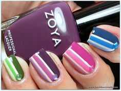 Different color on each finger, bright color and white stripes, crystal accents, free hand nail art