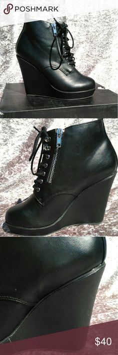 Torrid Lace Up Wedge Booties w/faux zips 8W The perfect pair of shoes to express your bad attitude.  Black faux leather platform wedges. Approximately 4.25 in heel w/ a 1in platform to make them more comfortable and stable. They're 90's inspired, with faux zippers and silver lace up grommets. I have the box, but would rather not ship it if possible to keep the weight down. Thanks so much for visiting my closet. I always entertain offers and I love to bundle and give you even deeper…