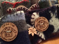 Felted from old wool sweaters, these coffee cozies help to keep coffee warm and fingertips cool.
