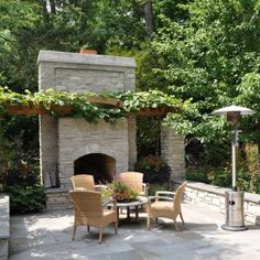 Patio with modern brick fireplace design. Milieu Design