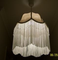 Original fabric - Acanthus pattern in a taupe, washed and dried with a long fringe and a touch of bling. Shade cost $1 - fringe, braid and dangling bling crystals about $20 AUD. The material was left on and scrubbed up like new!