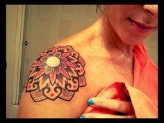 Red and black mandala tattoo