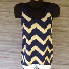 Flowy Racerback top Chevron pattern. Like new condition. Third picture is the accurate color. Will fit a S-L Charlotte Russe Tops