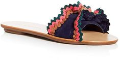 """Loeffler Randall Women's Birdie Suede Ruffle Slide Sandals. Leave it to Jessie Randall to make rickrack feel super modern. This season, the brand re-created its most popular style (the """"Vera"""") and turned it into a beach-y slide. Easy to pair with a one-piece bathing suit, but still dressy enough (thanks to those ruffles) to wear out at night."""