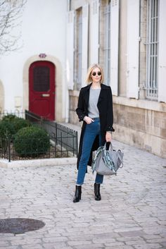 Black trench coat and straight fit jeans