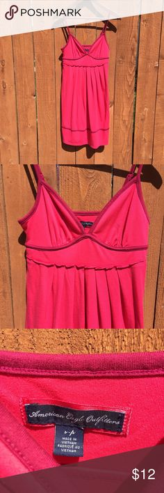 American Eagle pink cami empire waist dress S Cami straps and contrast piping. Empire waist with pleats. Gently used - some pilling/fuzzies from wash wear. Approximate flat measurements: chest 14in, waist 13in, length 34in (give or take a few inches because of the adjustable straps). American Eagle Outfitters Dresses
