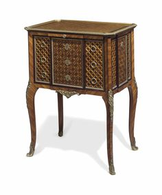 A FRENCH ORMOLU-MOUNTED MAHOGANY, TULIPWOOD AND PARQUETRY OCCASIONAL TABLE BY MAISON KRIEGER, PARIS, EARLY 20TH CENTURY