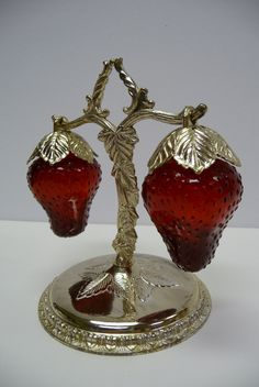 Vintage strawberry salt and pepper shakers. I found a set like this at an antique shop & gave them to my best friend. She collects strawberry stuff. They are beautiful.