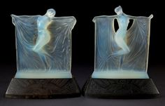 R. LALIQUE OPALESCENT GLASS SUZANNE AND THAIS STATUETTES ON BRONZE ILLUMINATING BASES . Circa 1925, .