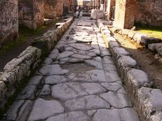 One of the streets in Pompeii showing the cart tracks worn into one of the Roman roads through the town.