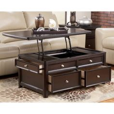 Offering everything from a spring-loaded tabletop and front and side drawers, to the option of casters—this lift-top coffee table is packed with pleasant surprises. Made from practical manufactured wood with espresso-finished veneers, this charming table features recessed paneling for traditional appeal, while satin nickel-tone hardware adds a clean, modern touch. Keep your space uncluttered by storing coasters, remotes, and extra batteries in the four drawers, and use the lift-top function…