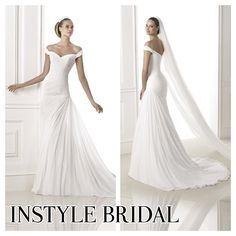 Pronovias soft chiffon, off the shoulder, V-back fit and flare wedding dress available at InStyle Bridal, Drummoyne Sydney
