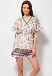 5aeb834b9d Enjoy a good night s sleep or a relaxed time at home wearing this peach  coloured nightwear