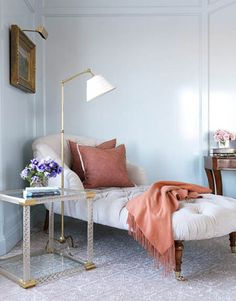 A chaise in the corner of the master bedroom creates a cozy area to nap or read.
