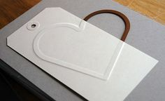 Dry Embossing with Wafer Thin Dies - embossed tag - lots of great ideas to use other materials to emboss!