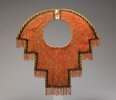 Collar, 12th–14th century Geography: Peru, Culture: Chimú - Medium: Spondylus shell and black stone beads, cotton