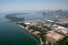 view of Toronto Islands (harbour, airport, Centre Island, etc) and downtown in the background