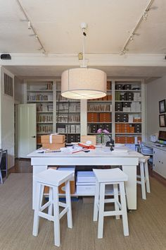 """Min/ Cottage  with the inevitable """"stuff"""" required in an office :)  Work Space - A drum-shade light suspended above a white table  Tara Guerard  June 2013 Lonny Magazine"""