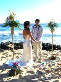 Blue Orchid Flowers created these beautiful floral tiki torches for our Hawaiian Style Wedding at Shipwrecks Beach - Kauai
