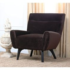 @Overstock.com - Abbyson Living Malibu Dark Brown Microsuede Armchair - Contemporary styling and comfort go hand in hand with this microsuede uphostered armchair. The dark brown fabric is soft to the touch, and it's durable enough to hold up to regular use. Espresso stained legs complete the classy look of this piece.  http://www.overstock.com/Home-Garden/Abbyson-Living-Malibu-Dark-Brown-Microsuede-Armchair/6761773/product.html?CID=214117 $321.29