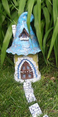 Mushroom house fairy gnome garden over a foot tall HANDMADE. $49.99, via Etsy.