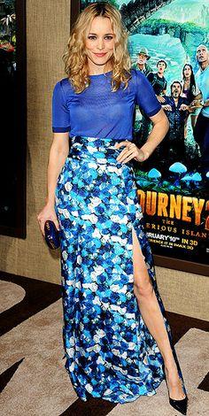 Rachael McAdams in a sheer top and high waisted skirt.