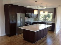 Good looking tiny kitchen! Hardwood, Island, Marble - simple, Contemporary, European, L-Shaped, Undermount, Pendant