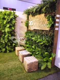 Plants as walls and flooring with burlap covered ottomans!