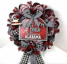 Alabama Crimson Tide Fan With Welcome Sign Deco Mesh Door Wreath. This Alabama Crimson Tide with Welcome Sign Deco Mesh Door Wreath is made with deluxe Crimson,black and white deco mesh. it's accented with 2 Big Al elephants, cute little footballs,official licensed Riddell helmet ,and topped off with a Saban and The Bear Hats. Be the envy of your neighborhood and show your team colors with beautiful Alabama Fan Wreaths Need a Custom design for your team including high schools. Need a…
