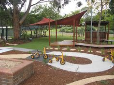 Strathfield One stop Child Care Service (SOCCS) Strathfield, Sydney, New South Wales. 3 - 4 YO playspace, After, 2012.  A new mixed surface bike track, Replas seats, numerous informal semi secluded seating areas, raised pathways, multi-purpose platform a covered cubbyhouse/outdoor classroom area and a variety of sensory plantings.