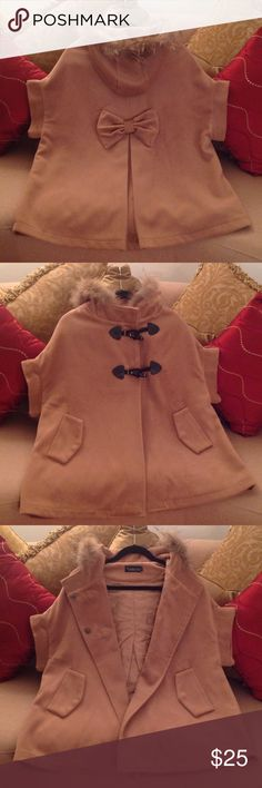🍃🌹'Baxianshu' - Camel Swing Cape Really cute, this little Coat is!!  Size extra small but fits a small just as good. It's a Polyester blend with a Faux Fur trimmed hood. It has a two button closure in the front, and the 'Bow' in the back.  And it has Pockets!!! So Uniquely different for us Gals who truly like to stand out! You will get lots of compliments when paired with your own unique pieces: a Black turtleneck, Jeans and Boots!  A chunky statement necklace or Bracelet. You can add a…