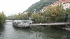 World's Weirdest Bridges (PHOTOS) | The Weather Channel--  Two footbridges and an artificial 'island' built in the shape of a seashell connect the two banks of the Mur river in Graz, Austria. The island holds a cafe, children's playground and even a amphitheater. (Wikimedia/Zmurkobill)
