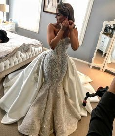 This beaded wedding gown has a mermaid cut. The strapless design also has a ballgown detachable overskirt. Our US dress design team out of Dallas can create all types of custom #weddingdresses like this that will not cost a fortune. We also specialize in inexpensive #replicas of couture #dresses too. So if what you want is too pricey for your budget we canhelp. Our inspired version willhave the same overall look but cost way less. Email us for pricing!
