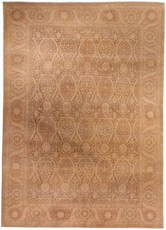 A simple en camaïeu pattern of repeated botanical motifs overall characterizes this new rug.