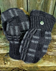 These handmade mittens are made from a black and gray crisscross patterned recycled sweater. They are lined with a doft, warm black fleece with a tapered to fit thumb and a repurposed button detail. Sweater Mittens, Gray Sweater, Sweaters, School Sets, Teaching Art, Knitted Hats, Black And Grey, Knitting, Trending Outfits
